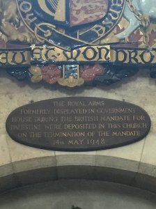 The sign marking the coat of arms that once hung at the British government offices.