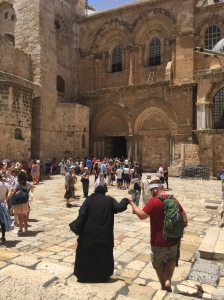 As Rob was posing for a photo in front of the entrance of the Holy Sepulchre, a little Nana asked for a hand down the smooth steep steps.