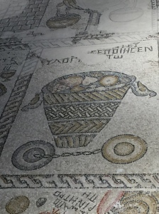 The mosaic depicts the first fruits which are given to God as an offering of thanksgiving.