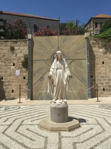 A statue of Mary set in the heart of a labyrinth.