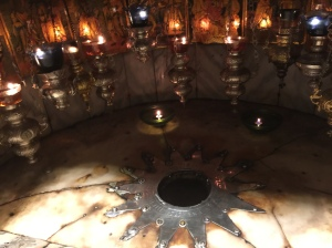 The grotto of the Nativity.  The star marks the spot of Jesus' birth.
