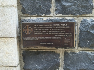 A plaque commemorating the visit of Pope John Paul II in 2000.