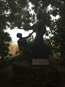 A statue commemorating the calling of Peter and Peter denying that call because he considered himself a sinner.