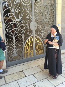 A kind nun opening the church for the afternoon.