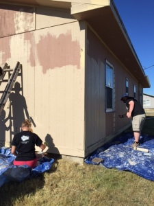 Laurel and Fr. Rob painting.