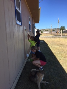 Alissa, Laurel, and Jolena, the little girl who lives in the house we were working on...and yes we are painting, I think y'all get the picture of our morning.