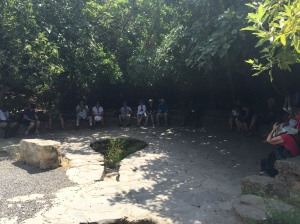 The group sitting in the shaded area to listen to the stories of Jesus in Caesarea Philippi and Peter's Confession.