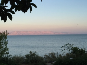 The last rays of sun cast upon the Golan Heights across the Sea of Galilee.