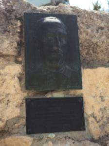 A plaque acknowledging Italian architect Antonio Berluzzi.