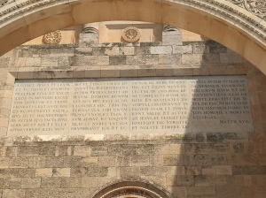 The story of the transifguration etched into the stone above the entrance.
