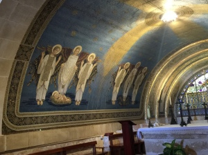 The mural on the left side of the lower altar depicting scenes of Jesus' life.