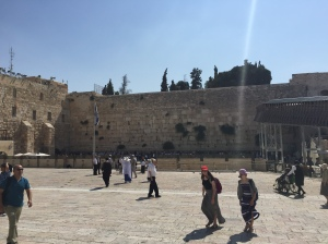 The plaza in front of the western Wall with two sections a large section for the men in the center and left, and a smaller section for women on the right.