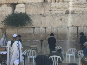 Jewish men praying at the Western Wall.