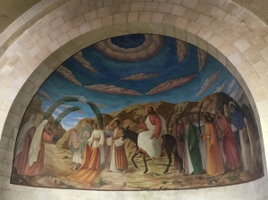 The mural above the altar in the sanctuary depicting Jesus' entrance into the city.