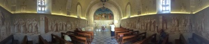 A panoramic view of the church...the walls are covered in etched depictions of the story of Jesus on Palm Sunday.
