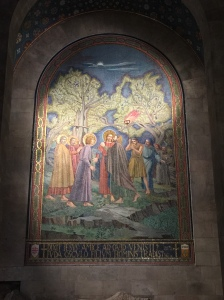 A mural depicting parts of the story of Jesus in the garden.