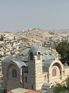 The church and in the far distance the separation wall.