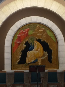 An icon behind the altar on the second level.