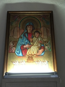 An icon of Mary above the Ark of the Covenant...Mary is seen as the bearer of the new covenant and the ark bearing the old covenant of Moses, the Ten Commandments.