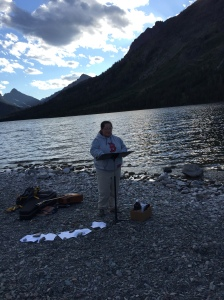 Rev. Lauren leading the group in the Liturgy of the Word on the shores of Two Medicine Lake.