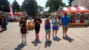 The group walking through the midway at the state fair.